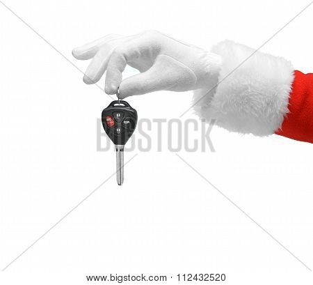 Hand in costume Santa Claus is holding car keys