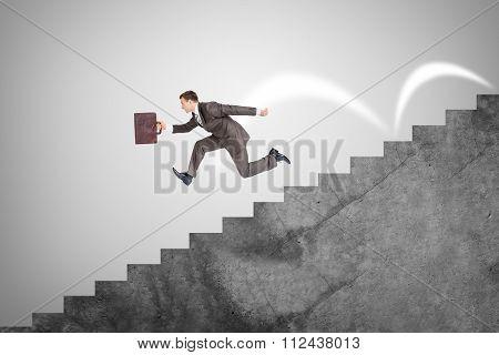 Businessman running down stairs