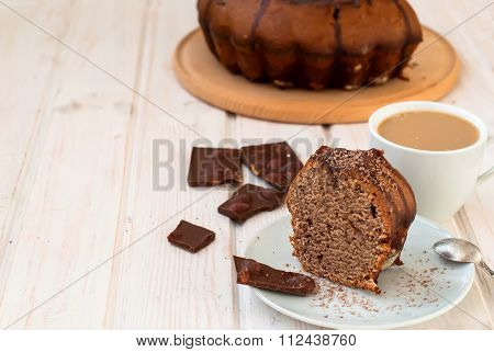 Piece Of Chocolate Cake With Chocolate Crumb Topping And A Cup Of Coffee And Milk For Breakfast