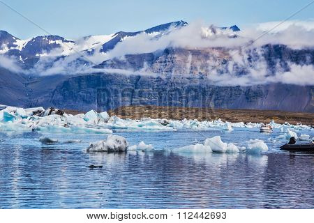 Ice lagoon in Iceland. Beautiful summer morning in the ocean bay with ice floes