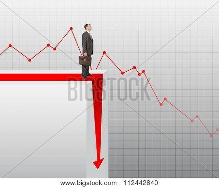 Businessman standing on edge of chart