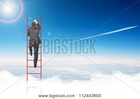 Businessman climbing ladder in sky