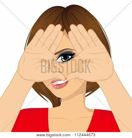 woman looking through triangle shape sign made with her hands