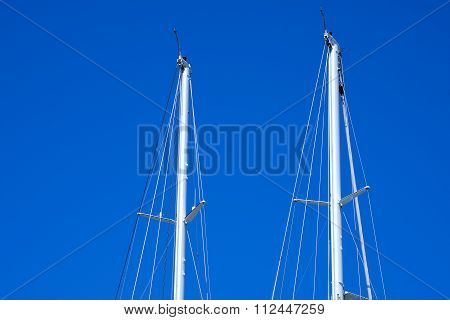 Masts Of Sailboats Against A Blue Sky