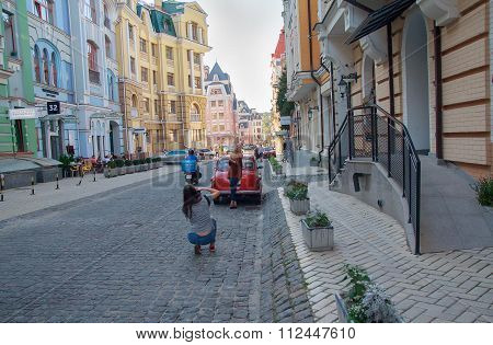 Kiev, Ukraine - September 20, 2015: Girls are photographed at the Podil -in the historic quarter of