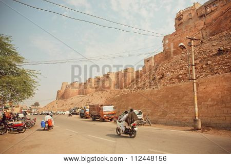 Motorcycle Driving On Dirt Road Near Historical Jaisalmer Fort Built In 1156 Ad In India