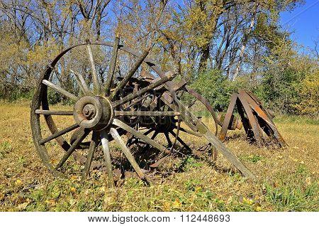 Wood wagons wheels in a field