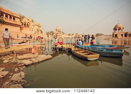 Riverboats With Relaxing People On River With Ancient Indian Towers Around In India