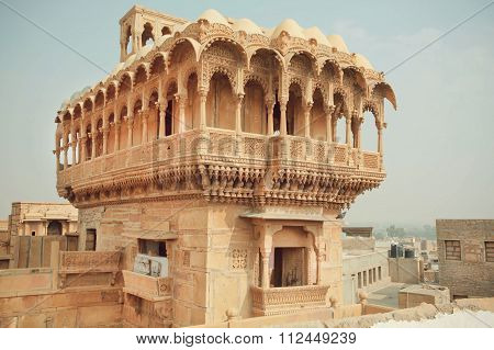 Carved Tower With Stone Balconies Of Ancient Indian House In Old Town In India