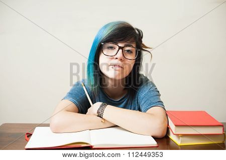 Young Female Student With Red Book