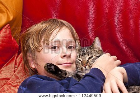 Young Boy Is Hugging With His Cat