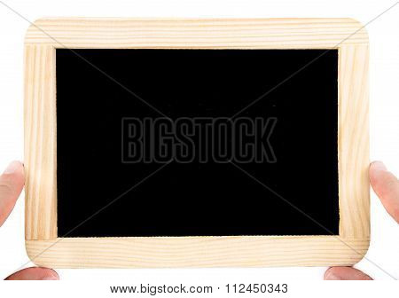Close Up On Pair Of Hands Holding A Wooden Frame Chalkboard Isolated On White