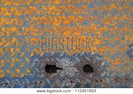 Close up of old and dirty metal diamond plate of drain cover