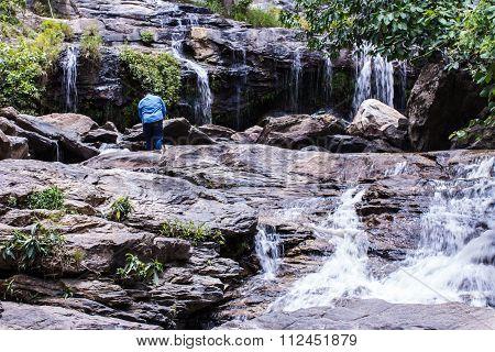 Male Photographer Taking Photos In A Waterfall, Mae Ya Waterfall