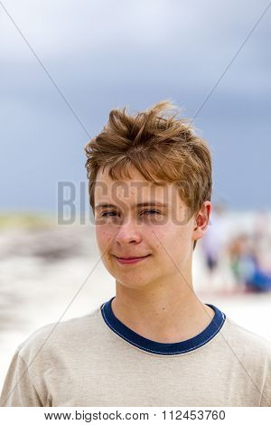 Young Happy Handsome Boy At The Beach