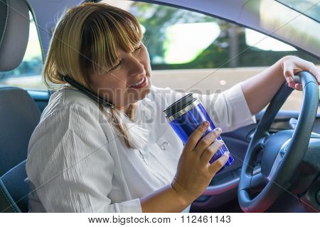 Portrait Of A Woman Driving A Car With His Hands Busy