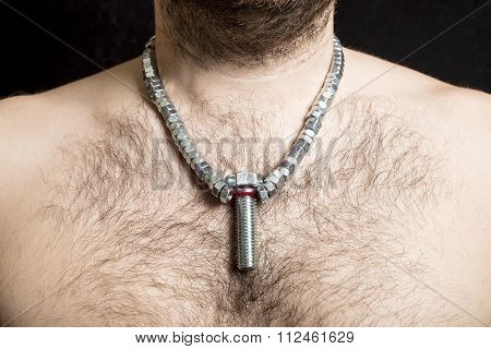 A Male Worker With A Bare Hairy-chested, Wearing A Necklace Around The Neck Of The Screws Nuts