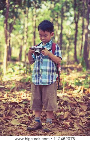Asian Boy Checking Photos In Digital Camera. Vintage Picture Style.