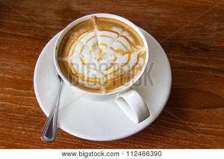 Closeup, Hot Caramel Macchiato in white coffee cup