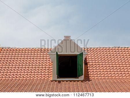 Dormer In Red Tile Roof