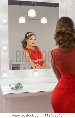 beautiful sexy gorgeous girl in red evening dresses with bright evening make-up evening hairstyle an