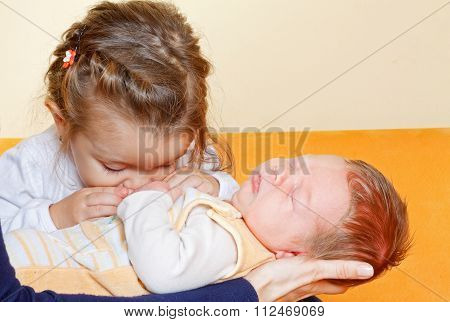Girl With Her Newborn Brother
