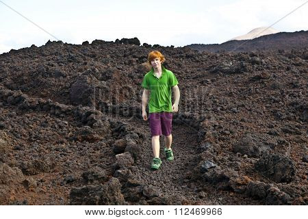 Boy Walking In Volcanic Area