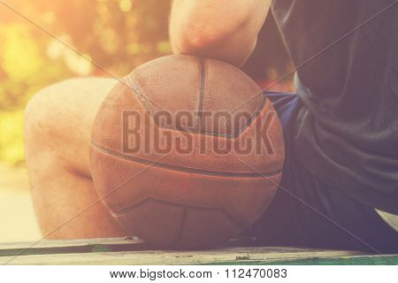 Basketball player sitting on a bench