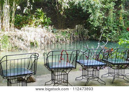 Black Metal Chair Beside The Creek