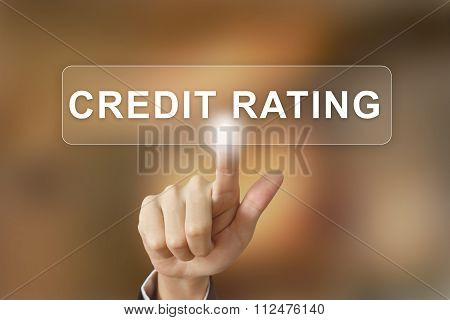 Business Hand Clicking Credit Rating Button On Blurred Background
