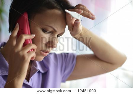 Sick woman calling to the doctor