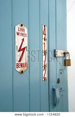 Colorful Electrical Room With Warning Sign.