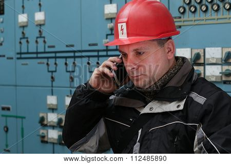 Technician Make Phone Call In The Power Plant Control Center
