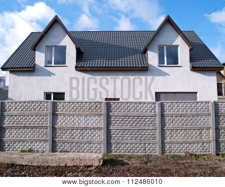 Concrete Fence And The House