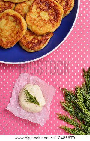 potato pancakes and garlic sauce on kraft paper