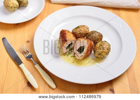 Chicken Kiev with potatoes and dill, dish, knife