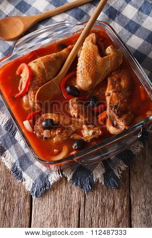 Pieces Of Chicken Stewed In Tomato Sauce Close-up. Vertical