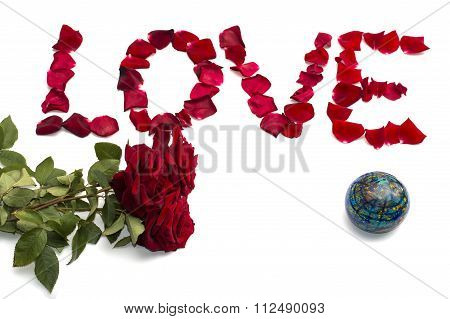 Inscription Love From Petals Of Roses And A Bouquet Of Scarlet Roses