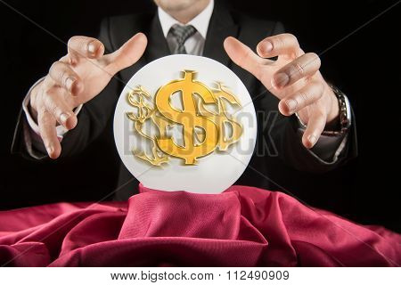 Fortune teller businessman, sees the dollar in a crystal ball