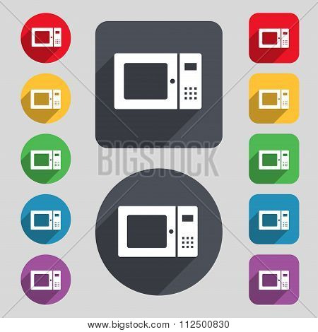 Microwave Icon Sign. A Set Of 12 Colored Buttons And A Long Shadow. Flat Design.