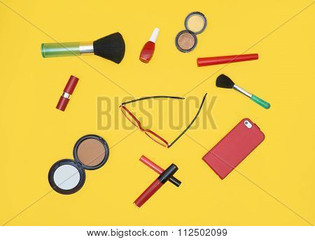 Set Of Red Cosmetics With Red Glasses