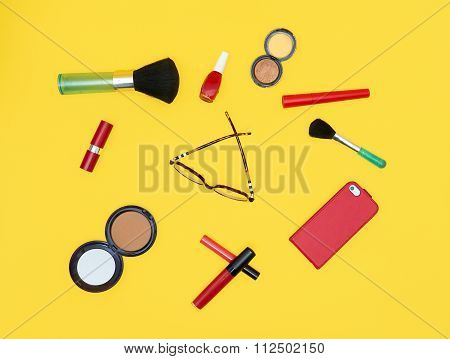 Set Of Red Cosmetics With Glasses