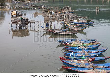 Floating colorful boat of Vietnamese fisher anchoring on Lang Co bay