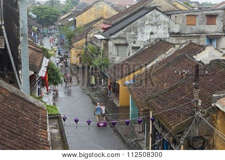 Tourist taking a tour to discover Hoi An ancient town by cyclo