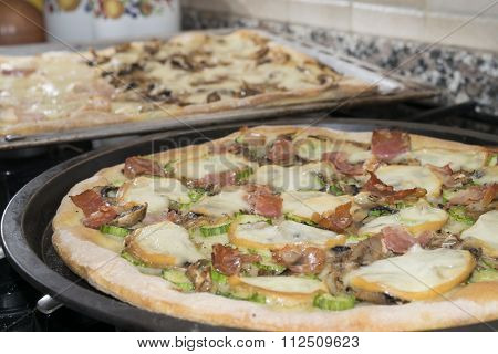 Homemade Pizza With Scamorza And Cured Ham