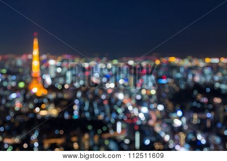 Blurred bokeh light, Tokyo tower and city aerial view