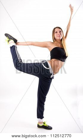 beautiful fit woman dancing in tracksuit