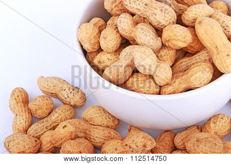 Monkey Nuts, Peanuts Or Groundnuts In Shells, Isolated On A White Background In Cup