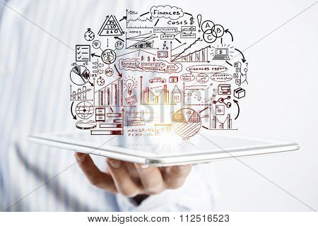 Businessman hands demostrating business strategy plan on tablet screen
