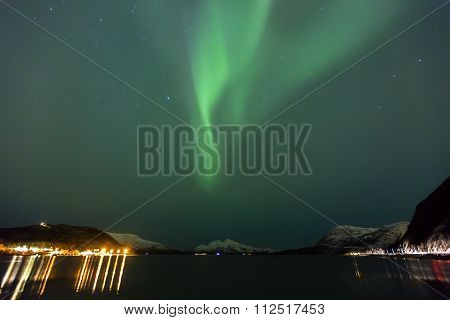 Beautiful northern lights over a fjord at night
